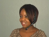 Beautiful Customer Service Operator with Headset Microphone Stock Footage