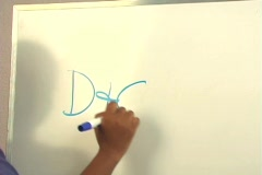 "Beautiful Nurse Writes ""D&C"" on a White Board (close-up). Stock Footage"