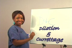 "Beautiful Nurse Writes ""D&C"" on a White Board. Stock Footage"