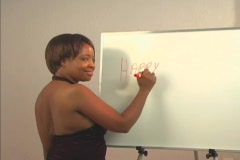 """Sexy woman writes """"Happy Birthday Handsome"""" on a white board Stock Footage"""