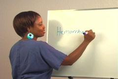 "Beautiful Nurse Writes ""Hemorrhoidectomy"" on a White Board Stock Footage"