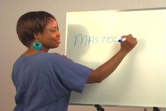 "Beautiful Nurse Writes ""Mastectomy"" on a White Board Stock Footage"