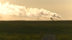 The environment, pollution exhaust stack over rural field Stock Footage