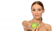 Portrait of beautiful and sexy woman, holding apple Stock Footage