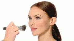 Makeup artist is doing makeup on beautiful woman Stock Footage