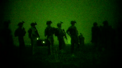 Troops Prepare to board Helo under Night Vision (HD) m Stock Footage