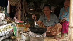 Karen Refugees: Woman cooks Stock Footage