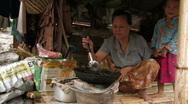 Stock Video of Karen Refugees: Woman cooks Stock Footage