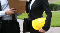 Man and woman engineers clipboard Stock Footage