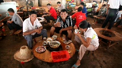 Chinese eating hot pot in the market Stock Footage