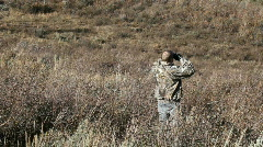 Hunter in camo binoclulars P HD 3580 Stock Footage