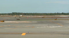 Plane lands on runway (1 of 3) Stock Footage