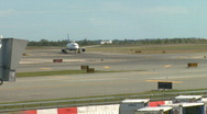Stock Video Footage of Plane sits on tarmac (1 of 2)