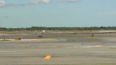 Plane taxis on runway (1 of 2) Stock Footage