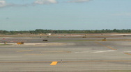Stock Video Footage of Plane taxis on runway (1 of 2)