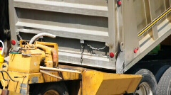 Paver being loaded Stock Footage