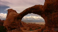 Arches 11 Double O Arch Bird Fly Through Loop Footage