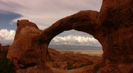 Stock Video Footage of Arches 11 Double O Arch Bird Fly Through Loop