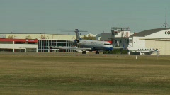 Aircraft, CRJ jet, United Exprerss taxi and turn Stock Footage