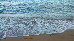 Footsteps on the sand and wave Stock Footage