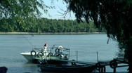 Young woman waiting on the pontoon  Stock Footage