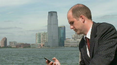 Professional on phone at waterfront (4 of 4) Stock Footage
