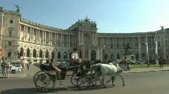 Horse drawn carriage in front of the Hofburg Palace in Vienna, Austria - stock footage