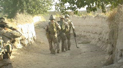 SF soldiers using a metal detector m Stock Footage