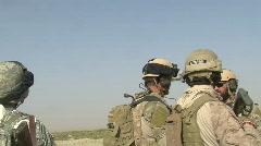 Huey flies by troops (HD) m Stock Footage