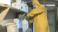 Measuring out spray chemicals Stock Footage