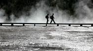 Man woman silhoutte boardwalk Stock Footage