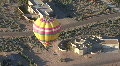 Hot Air Balloon Above Desert House HD Footage