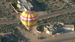 Hot Air Balloon Above Desert House Stock Footage