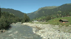 Creek runninng through Swiss Countryside in Switzerland, Europe Stock Footage
