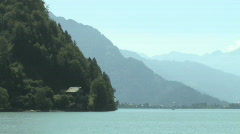 Stock Video Footage of Hazy Swiss Alps over a lake in Switzerland, Europe