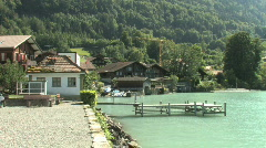 Swiss village on a lake in Switzerland, Europe Stock Footage