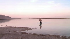 A man swimming in the Dead sea Stock Footage