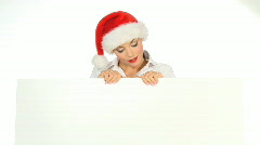 Girl in santa claus hat holding empty board Stock Footage