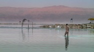 A sexy women in the dead sea 1 Stock Footage