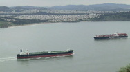 Stock Video Footage of Cargo Container Ships Pass Wide 59.94
