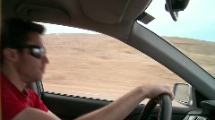 Dancing and driving in the desert Stock Footage