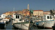 Stock Video Footage of Fishing boats moored in the harbor at Rovinj Croatia.
