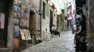 Stock Video Footage of Narrow cobbled shopping street in Rovinj Croatia.