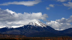 Time Lapse Clouds over Snowy Mountain Peaks Stock Footage