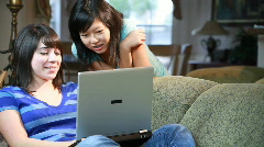 Girls studying on laptop Stock Footage