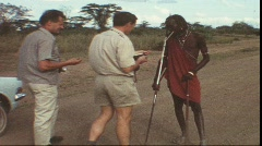 Tourists tipping Massai in Kenya (vintage 8 mm-film) Stock Footage
