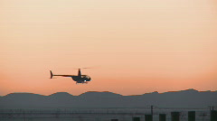 Helicopter turns silhouette  Stock Footage