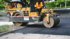 Road roller compacting new asphalt - stock footage