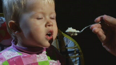 Child feed from a spoon 02 Stock Footage