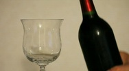 Stock Video Footage of Red Wine Poured from Bottle into Glass